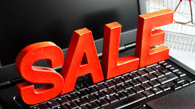 Sale letters on laptop shopping online sign Stock Photo