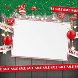 Sale Lines Christmas Card Wood. Sale lines with twigs, card and baubles on the wooden background Stock Photos