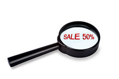 Sale in magnifier Stock Image