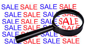 Sale in magnifier Stock Images