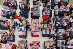 Sale in the mall in Kuala Lumpur, Malaysia. Kuala Lumpur, Malaysia - September 22, 2016: People choose clothes at the sale in the mall in Kuala Lumpur, Malaysia Royalty Free Stock Photography