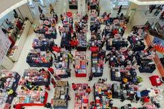 Sale in the mall in Kuala Lumpur, Malaysia. Kuala Lumpur, Malaysia - September 22, 2016: People choose clothes at the sale in the mall in Kuala Lumpur, Malaysia Stock Photo