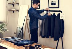 Sale man setting the suits for sales royalty free stock photos