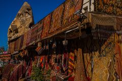 Sale in the market, Turkish Bazaar on the street, front view of different carpets at market in Cappadocia, Turkey. Sale in the market, Turkish Bazaar on the royalty free stock photo