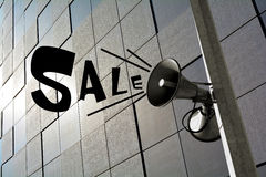Sale. Megaphone advertises a Sale in a City royalty free stock photo