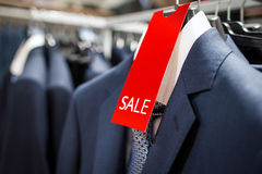 Sale in men's boutique of classical clothes Royalty Free Stock Images