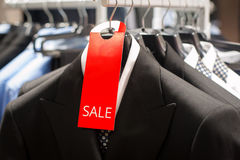 Sale in men's boutique of classical clothes Stock Photo