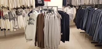 Sale of men`s clothing in the store Zolla royalty free stock image
