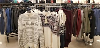 Sale of men`s clothing in the store Zolla stock photos