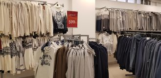 Sale of men`s clothing in the store Zolla royalty free stock photography