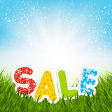 Sale message on green grass Royalty Free Stock Image