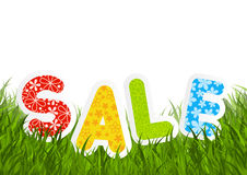 Sale message on green grass Stock Image