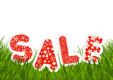 Sale message on green grass Royalty Free Stock Photos