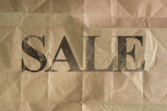 SALE message written on wrinkle brown bag texture Royalty Free Stock Image