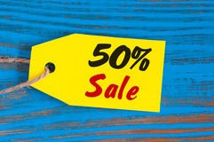 Sale minus 50 percent. Big sales fifty percents on blue wooden background for flyer, poster, shopping, sign, discount Stock Photos