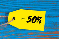 Sale minus 50 percent. Big sales fifty percents on blue wooden background for flyer, poster, shopping, sign, discount Stock Photography