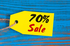 Sale minus 70 percent. Big sales seventy percents on blue wooden background for flyer, poster, shopping, sign, discount Stock Images
