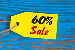 Sale minus 60 percent. Big sales sixty percents on blue wooden background for flyer, poster, shopping, sign, discount Stock Photo