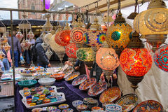 Sale of mosaic glass lamps and pottery at the street shop Stock Photography