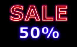 Sale neon 50% off neon sign. On black promoting sales for holidays and all events Stock Image