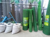 Sale of nets, rabits, sacks with a mixture. Royalty Free Stock Photography