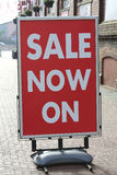 Sale Now On. A big board outside a shop confirming a sale is on Royalty Free Stock Photography