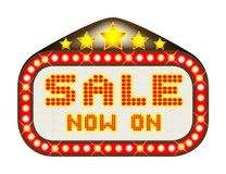 Sale Theatre Marquee On White. A Sale Now On movie theatre or theatre marquee Stock Images