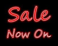 Sale now on neon glowing sign in red Royalty Free Stock Photo