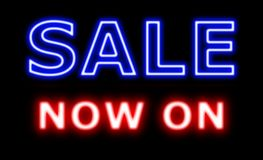 Sale now on neon sign shop. In blue and red Stock Image