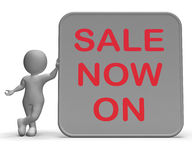 Sale On Now Sign Shows Product Specials. Sale On Now Sign Showing Product Specials And Lower Prices Stock Photos