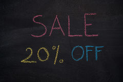 Sale 20% off on chalkboard. Sale 20% off. Sale and discount price sign drawn with chalk on blackboard Stock Images