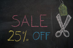 Sale 25% off on chalkboard. Sale 25% off. Sale and discount price sign with scissors cutting price tag drawn with chalk on blackboard Stock Images