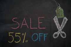 Sale 55% off on chalkboard. Sale 55% off. Sale and discount price sign with scissors cutting price tag drawn with chalk on blackboard vector illustration