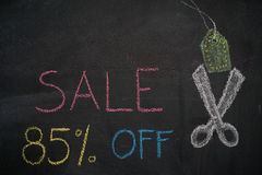 Sale 85% off on chalkboard. Sale 85% off. Sale and discount price sign with scissors cutting price tag drawn with chalk on blackboard vector illustration