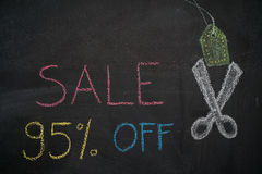 Sale 95% off on chalkboard. Sale 95% off. Sale and discount price sign with scissors cutting price tag drawn with chalk on blackboard royalty free illustration