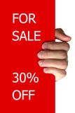 For Sale Off. Hand holding a red board/card withFOR SALE and 30% OFF stock photography