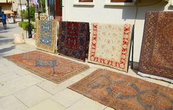 Sale of old carpets in the easten town stock image