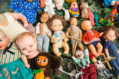 Sale of old dolls at a flea market Stock Image