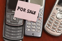 For sale old handphone. Concept - with old model phones Royalty Free Stock Image