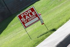 For Sale by Owner. A common For Sale by Owner sign promoting real estate Royalty Free Stock Photo