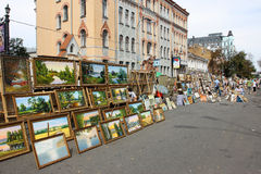 Sale of paintings on the touristic street Royalty Free Stock Photo