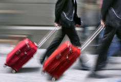 Sale. People with suitcases in a hurry. Stock Photos