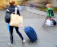 Sale. People with suitcases in a hurry. Intentional motion blur Royalty Free Stock Photo