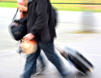 Sale. People with suitcases in a hurry Royalty Free Stock Photos