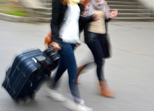 Sale. People with suitcases in a hurry. Intentional motion blur Royalty Free Stock Photos