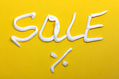 Sale and percent sign on a yellow background Royalty Free Stock Photography