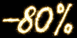 -80% Sale percents made by sparkler. Isolated on a black background. Stock Photo