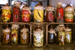 Sale of pickled bananas on the market in Istanbul. Banks with bananas, peppers, lemons, carrots, cucumber, watermelon. stock images