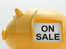 On Sale Piggy Bank Shows Discounts And Promotion Stock Photo