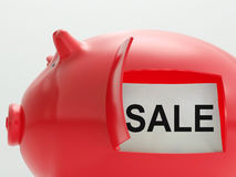 Sale Piggy Bank Shows Reduced Price And Bargains Royalty Free Stock Photos